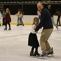 John Cotman and his daughter Liana, 6, skate together Saturday at the BancorpSouth Arena