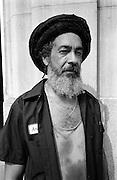 Rastafarian mechanic who's hat happens to be his hair.