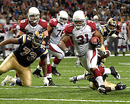 Arizona Cardinals running back Marcel Shipp (31) rushes up the middle for a Cardinals touchdown in the fourth quarter against St. Louis, at the Edward Jones Dome in St. Louis, Missouri, December 3, 2006.  The Cardinals beat the Rams 34-20.<br />