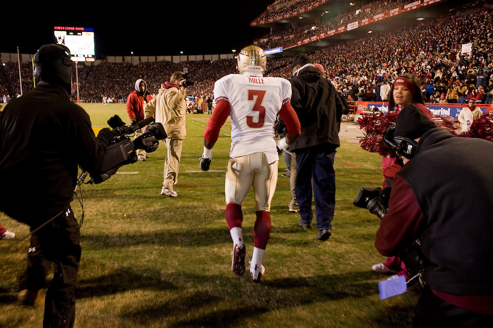College Park, Maryland - Florida State University football player Myron Rolle runs out to the playing field victoriously after winning a Rhodes Scholarship earlier that day, and then flying to a game against the University of Maryland Terrapins...Photo by Susana Raab