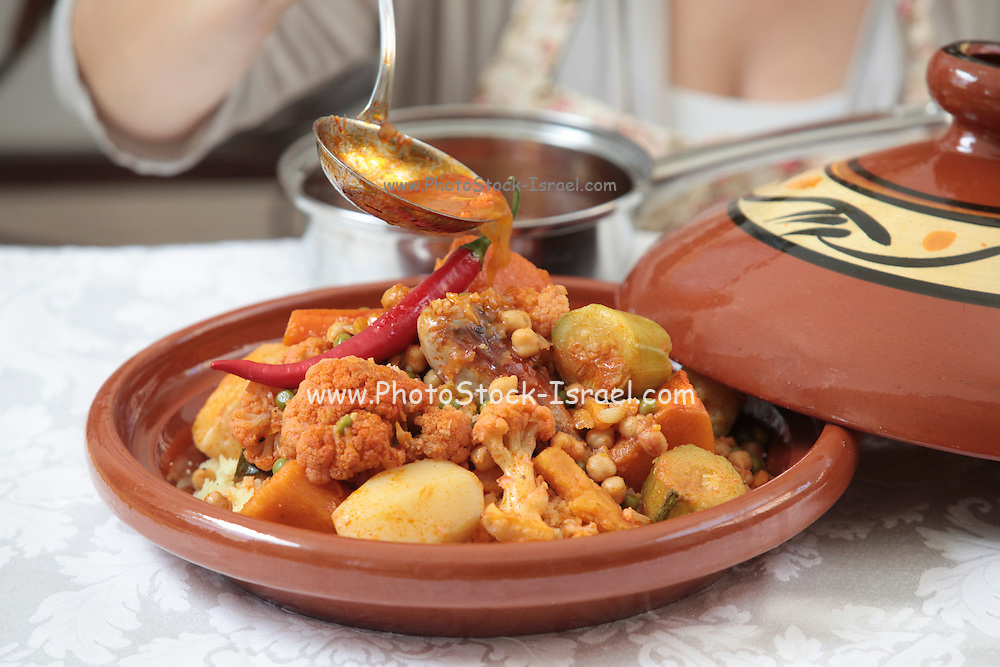 Moroccan food Chicken Tagine. Vegetables and chicken cooked in a Tagine.