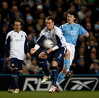 Photo: Jed Wee.<br /> Manchester City v West Ham United. The FA Cup. 20/03/2006.<br /> <br /> West Ham's Dean Ashton (L) controls the ball as Manchester City's Sun Jihai looks on.