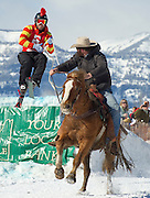 PRICE CHAMBERS / NEWS&amp;GUIDE<br /> Team Batman and Robin (Robyn is the Horse) put on a good show as skier Barton Slamey pulls in some rope coming off the second jump. With Brandon Whittington in the saddle, the skijoring team posted a time of 19.6 seconds on Sunday.