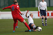 Blackburn Rovers Midfielder Jess Holbrook challenged by Preston North End Midfielder Jenna Carroll during the FA Women's Lancashire Cup Final match between Preston North End Ladies and Blackburn Rovers Women at the County Ground, Leyland, United Kingdom on 28 April 2016. Photo by Pete Burns.