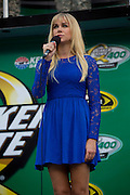 Country music singer Laura Bell Bundy performs the National Anthem before the start of the NASCAR Sprint Cup Series Quaker State 400 at Kentucky Speedway in Sparta, Kentucky on June 30, 2012.