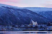 For around two months for the year, the area around Tromsø in northern Norway doesnæt see the sun. Photographed a week after the sun rose for the final time before winter, showing the glow against the clouds in late morning, above the Arctic Cathedral.