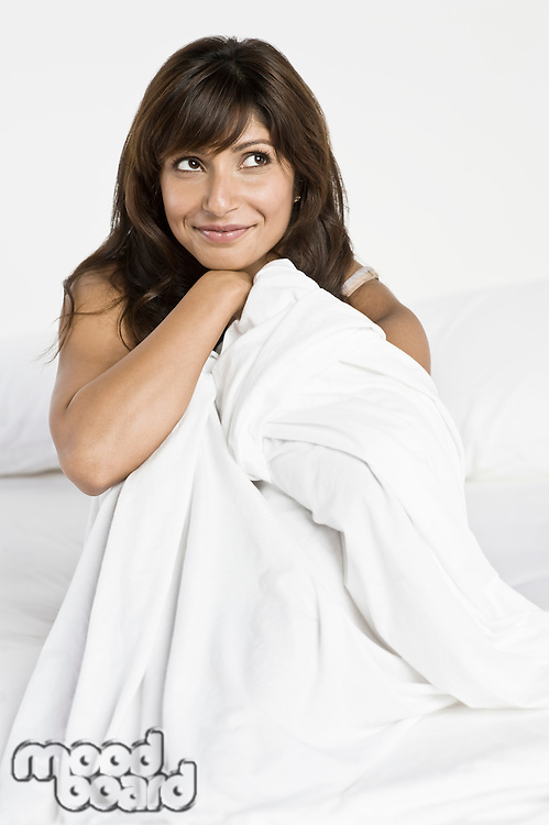 Mid adult woman in bed