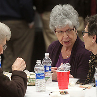 Betty McTune and Carolyn Clements, both of Tupelo, share conversation over their soup lunch Wednesday at the Salvation Army's 20th Annual Empty Bowls Luncheon in Building V of the Tupelo Furniture Market.