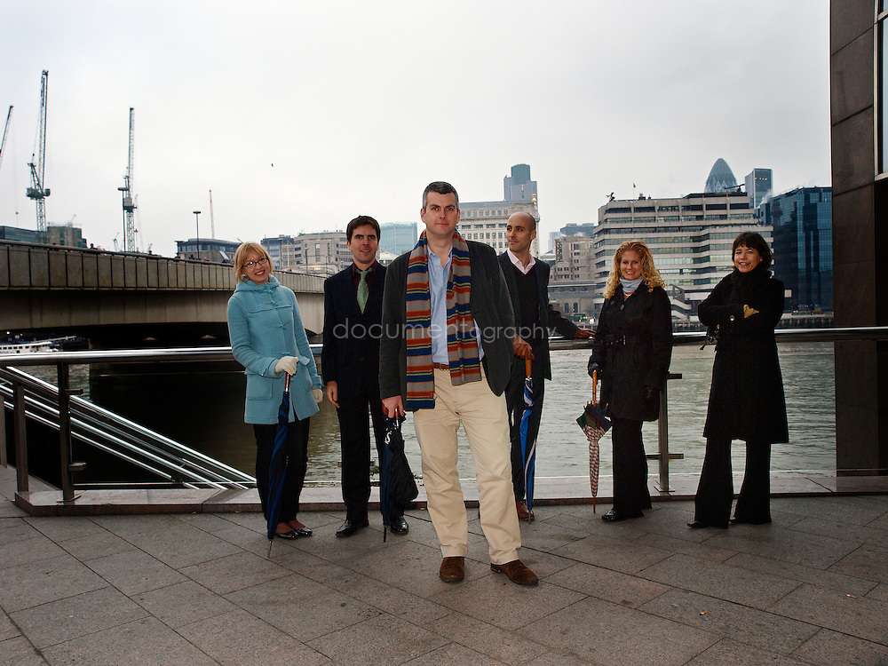 Martin Brookes (centre), Chief Executive of New Philanthropic Capital with behind him from left to right  - Eleanor Stringer - Analyst - Simon Blake - Senior Analyst - Gustav Lofgren - Analyst -  Liz Sklaroff - Senior Consultant and Sue Wixley - Head of Communication and Marketing, London Bridge, London, UK.