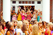 2009 Sorority Rush at the University of Georgia consists of hundreds of women marching for sorority mansion to mansion on Milledge Avenue as they check-out the Greek groups and the Greek groups check out them.