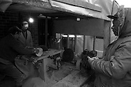 Striking miners from Armthorpe NUM cutting logs for firewood for other striking miners and retired members. 8 January 1985