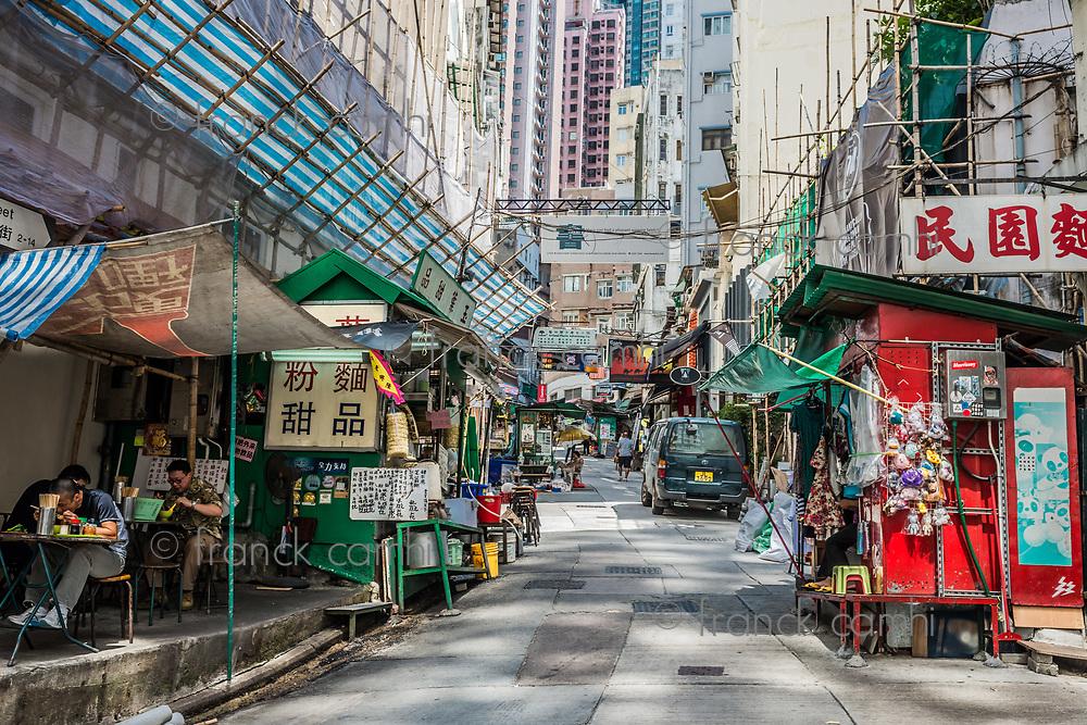 Central, Hong Kong, China- June 4, 2014: people and restaurants in Elgin Street at Soho