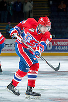 KELOWNA, CANADA -JANUARY 29:  Colton Bobyk D #32 of the Spokane Chiefs takes a shot during warm up against the Kelowna Rockets on January 29, 2014 at Prospera Place in Kelowna, British Columbia, Canada.   (Photo by Marissa Baecker/Getty Images)  *** Local Caption *** Colton Bobyk;