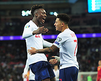 Football - 2019 / 2020 UEFA European Championships Qualifier - Group A: England vs. Montenegro<br /> <br /> Tammy Abraham of England celebrates scoring goal no 7 with Jadon Sancho, at Wembley Stadium.<br /> <br /> This game is England men's 1,000 international match.<br /> <br /> COLORSPORT/ANDREW COWIE