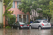 Homes and cars flooded in the historic district as Hurricane Joaquin brings heavy rain, flooding and strong winds as it passes offshore October 3, 2015 in Charleston, South Carolina.