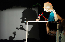 © Licensed to London News Pictures. 1704/2012. London, UK. Bickering snails, opera singing mice and a rather spineless swamp monster. Using shadow puppetry and bits of rubbish including tinsel and string, acclaimed  performer Jeff Achtem brings his gurgling new adventure about life in a swamp, with a stunning 3D finale. Photo credit : Tony Nandi/LNP