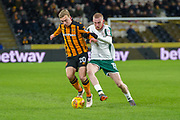 Jarrod Bowen of Hull City battles with Kieffer Moore of Barnsley during the EFL Sky Bet Championship match between Hull City and Barnsley at the KCOM Stadium, Kingston upon Hull, England on 27 February 2018. Picture by Craig Zadoroznyj.