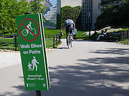Signage in Central Park: Walk Bikes on Paths