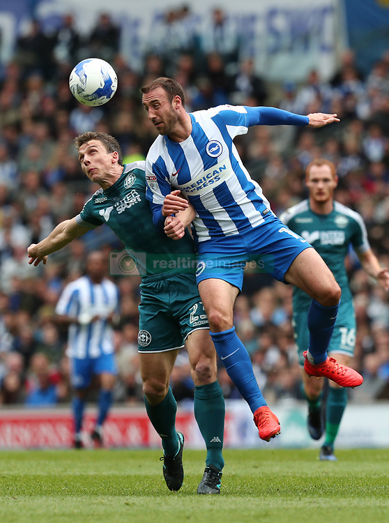 Brighton and Hove Albion's Glenn Murray (right) challenges Wigan Athletic's Stephen Warnock during the Sky Bet Championship match at the AMEX Stadium, Brighton.