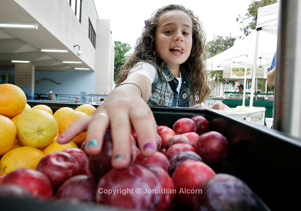 Healthy school lunches with fruit including plums and oranges in San Diego, California  /Jonathan Alcorn