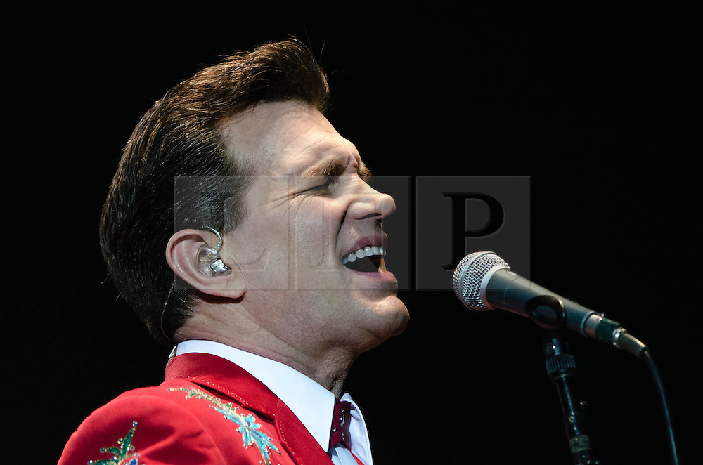 """© Licensed to London News Pictures. 09/10/2012. London, UK.   Chris Isaak performing live at Hammersmith Apollo. Christopher Joseph """"Chris"""" Isaak (born June 26, 1956 is an American rock musician and occasional actor.  He is touring to support his latest album """"Beyond the Sun"""", which consists of covers of songs by artists who recorded at the legendary Sun Studios in Memphis, Tenessee.   Photo credit : Richard Isaac/LNP"""