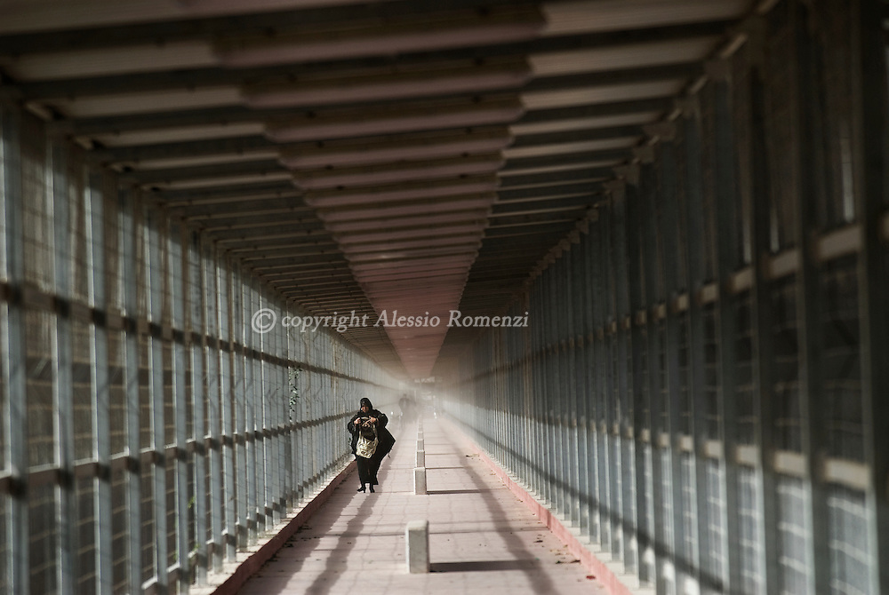 BEIT HANUN : Palestinian woman walk through the Erez border crossing with Israel in the northern Gaza Strip as they cross into Israel, on June 09, 2010.© ALESSIO ROMENZI