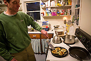 Lobsterman and fish buyer Sam Tucker fries pancakes at his home on Great Diamond Island, Maine. (Samuel Tucker is featured in the book What I Eat: Around the World in 80 Diets.) MODEL RELEASED