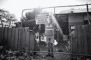 """Danger, Demolition work in progress"" This condemned house was for many homeless a home. After the house was demolished on September 22nd and a gate was placed, many of the homeless people made camp outside the gate and still remain there till this day. Broome, Western Australia. ©Ingetje Tadros/Diimex"