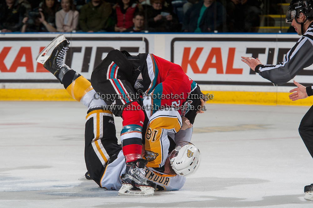 KELOWNA, CANADA - DECEMBER 3: Devante Stephens #21 of the Kelowna Rockets drops the gloves with Garrett Armour #18 of the Brandon Wheat Kings during second period on December 3, 2016 at Prospera Place in Kelowna, British Columbia, Canada.  (Photo by Marissa Baecker/Shoot the Breeze)  *** Local Caption ***