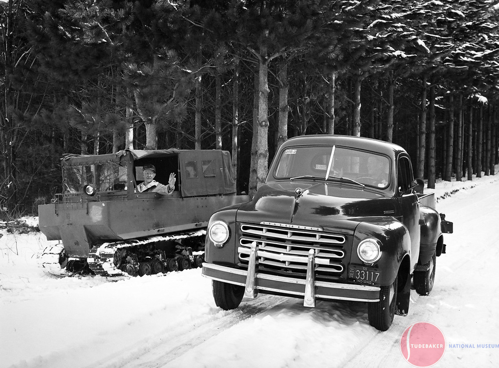 Studebaker 2R Series truck and a WWII-era Weasel.