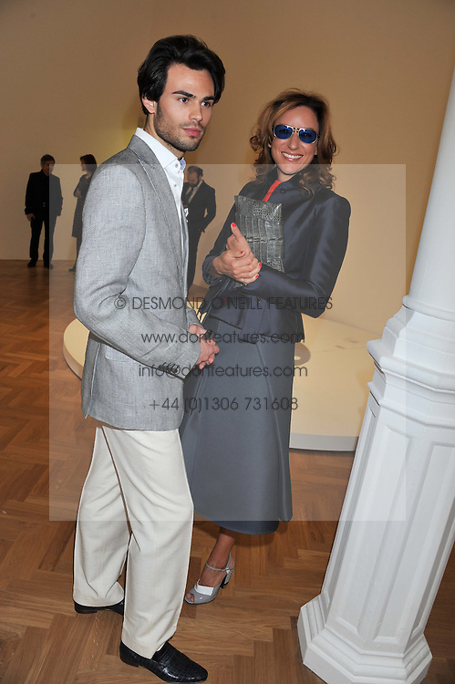 MARK-FRANCIS VANDELLI and REBECCA KORNER at a Private View of 'Calder - After The War' at Pace London, Burlington Gardens, London on 18th April 2013.