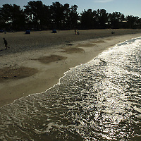 (02.03.2005)(PHOTO/CHIP LITHERLAND) -- A jogger heads for a morning run at Manatee Public Beach in Holmes Beach on Anna Maria Island Thursday, February 3, 2005.