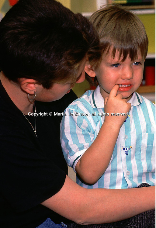 Teacher comforts a distressed child....