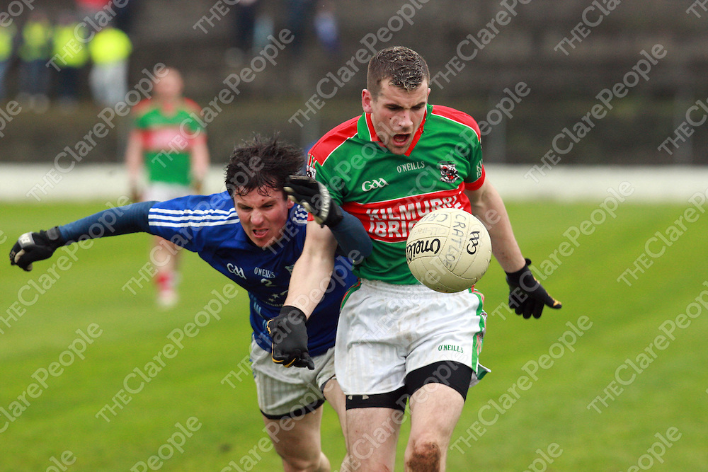 Kilmmurry Ibrickanes Mark McCarthy in possession from Cratloes Sean Chaplin in the Senior Football Championship semi-final played at Lissycasey. Pic Press 22.