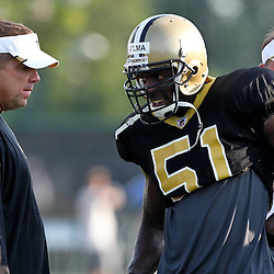 August 6, 2011; Metairie, LA, USA; New Orleans Saints head coach Sean Payton talks with linebacker Jonathan Vilma (51) during training camp practice at the New Orleans Saints practice facility. Mandatory Credit: Derick E. Hingle