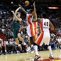 22 January 2012: Milwaukee Bucks small forward Mike Dunleavy (17) passes over Miami Heat point guard Mario Chalmers (15) during the Milwaukee Bucks 91-82 victory over the Miami Heat at the AmericanAirlines Arena, Miami, Florida, USA.