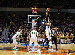 Dec 17, 2015; Charleston, WV, USA; West Virginia Mountaineers forward Jonathan Holton (1) and Marshall Thundering Herd forward James Kelly (24) jump for the tip at the Charleston Civic Center . Mandatory Credit: Ben Queen-USA TODAY Sports