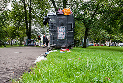 At the midpoint of the festivals season in Edinburgh residents and visitors have raised concerns about overflowing bins and discarded litter around the city centre, such as here in the Meadows.<br /> <br /> © Dave Johnston / EEm