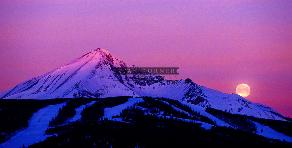 The moon sets as the alpenglow of the sunrise hits Lone Peak in Big Sky, Montana.  Limited Edition - 150
