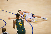 Golden State Warriors guard Klay Thompson (11) lays on the ground after being taken out by a Utah Jazz screen at Oracle Arena in Oakland, Calif., on December 20, 2016. (Stan Olszewski/Special to S.F. Examiner)