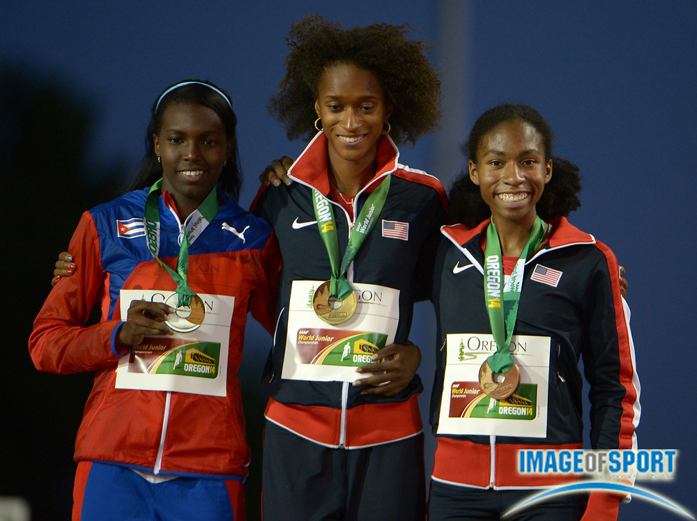 Jul 25, 2014; Eugene, OR, USA; Womens 400m winner Kendall Baisden (USA), center, poses with runner-up Gilda Casanova (CUB) and third-place finisher Olivia Baker (USA)at the 2014 IAAF World Junior Championships at Hayward Field.