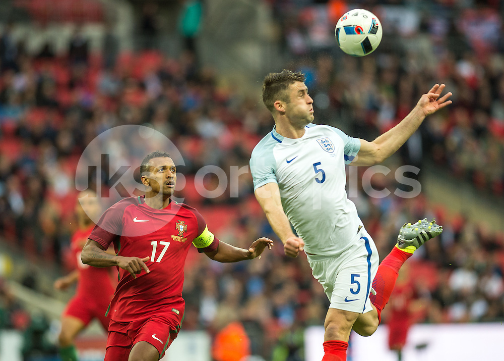 Gary Cahill of England heads the ball clear from Nani of Portugal during the International Friendly match between England and Portugal at Wembley Stadium, London, England on 2 June 2016. Photo by Vince  Mignott.