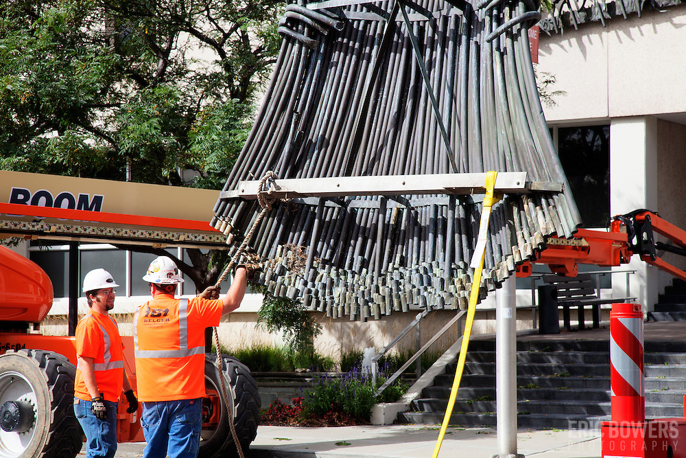 "Removal of ""Sheaves of Wheat"" metal sculpture by Belger Cartage from the exterior of the Kansas City Board of Trade building after acquisition and closure by CME Group. The sculpture was donated to Powell Gardens."