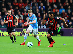 Manchester City's Kevin De Bruyne (centre) and Bournemouth's Nathan Ake battle for possession during the Premier League match at The Vitality Stadium, Bournemouth.