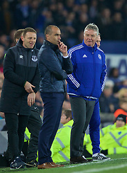 LIVERPOOL, ENGLAND - Saturday, March 12, 2016: Despite being beaten 2-0 Chelsea's manager Guus Hiddink still has a laugh with the fourth official during the FA Cup Quarter-Final match against Everton at Goodison Park. (Pic by David Rawcliffe/Propaganda)