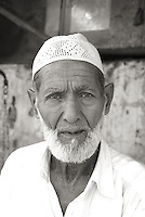 An elderly Muslim man in the streets of Old Delhi, India