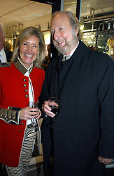 SUSIE BUCHANAN and ED VICTOR at the opening of Jack O'Shea's butcher, Montpelier Street, London on 9th November 2006.  <br />
