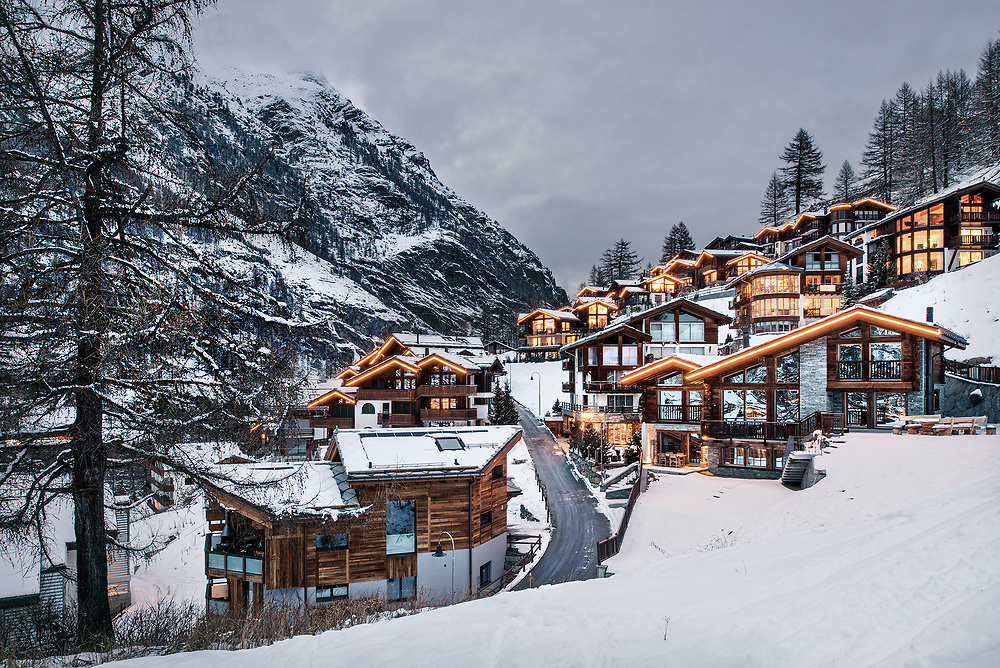 Modern chalet architecture at dusk in Zermatt Resort, Switzerland