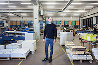 SOVERIA MANNELLI, ITALY - 17 NOVEMBER 2016: Florindo Rubbettino (45), CEO of Rubbettino Publishing House, poses for a portrait in the typgraphic warehouse in Soveria Mannelli, Italy, on November 17th 2016.<br /> <br /> Rubbettino Publishing House, founded by Rosario Rubbettino in 1973, is of the largest publishing and printing houses in Italy's South. To abate logistical costs and make sure of the production quality, Rubbettino Publishing House built an integrated cycle inside its large warehouse inside Soveria Mannelli. Over 80 employees edit, print and package 300 new books a year for the Italian market, generating a turnover of 8 million euros.<br /> <br /> Soveria Mannelli is a mountain-top village in the southern region of Calabria that counts 3,070 inhabitants. The town was a strategic outpost until the 1970s, when the main artery road from Naples area to Italy's south-western tip, Reggio Calabria went through the town. But once the government started building a motorway miles away, it was cut out from the fastest communications and from the most ambitious plans to develop Italy's South. Instead of despairing, residents benefited of the geographical disadvantage to keep away the mafia infiltrations, and started creating solid businesses thanks to its administrative stability, its forward-thinking mayors and a vibrant entrepreneurship numbering a national, medium-sized publishing house, a leading school furniture manufacturer and an ancient woolen mill.