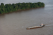 Barge carrying rocks<br /> Essequibo River<br /> GUYANA<br /> South America<br /> Longest river in Guyana